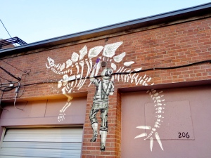 Dino Discovery by Kristina Wiltse for the Laramie Mural Project in Laramie, Wyoming